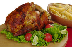 Roast Chicken. With lettuce, cherry tomatoes and french fries (Selective Focus, Isolated Stock Images