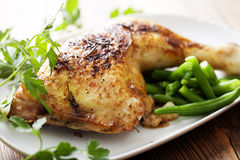Roast chicken. Closeup of roast chicken and oven potatoes royalty free stock photos