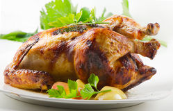 Roast chicken. With apples and herbs Royalty Free Stock Images