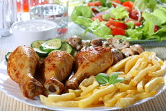 Roast chicken. With chips and vegetables royalty free stock photography