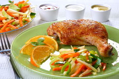 Roast chicken. And vegetable salad stock photography