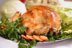 Roast Chicken. Tasty Crispy Roast Chicken on plate Royalty Free Stock Image