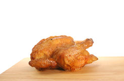 Roast chicken. Joint on a wooden board Stock Photo