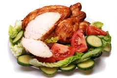 Roast chicken. And salad on a white background royalty free stock images
