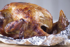 Roast chicken in aluminuim foil Stock Photos