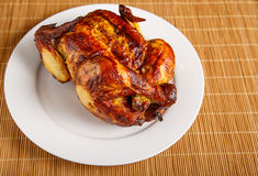 Roast Chicken at Angle on White Plate Royalty Free Stock Photos