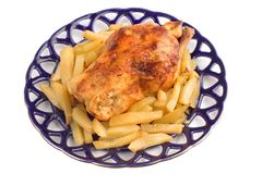 Roast chicken with baked potatoes Stock Photo