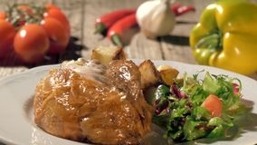 Roast chicken with baked potatoes and salad stock video footage