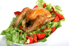 Roast chicken on a bed of salad Stock Photos