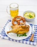 Roast chicken, beer, pretzel and potato salad Royalty Free Stock Photography