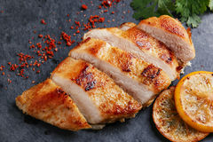 Roast chicken breast with lemon and vegetables Royalty Free Stock Photo
