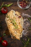 Roast chicken breast with Rosemary and vegetables on dark wooden background, top view, close up Stock Photo