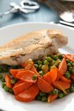 Roast chicken breast with vegetables on white plate Royalty Free Stock Photos