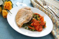 Roast chicken breast with vegetables on white plate Stock Images