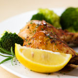 Roast chicken with broccoli royalty free stock photography