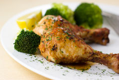 Roast chicken with broccoli and lemon Stock Image