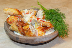 Roast chicken carcass with greenery on a Clay dishes Stock Image