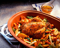 Roast chicken in clay pot Royalty Free Stock Photo