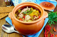 Roast chicken in a clay pot Royalty Free Stock Photography