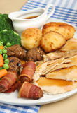 Roast Chicken Dinner. Traditional roast chicken dinner with all the trimmings and individual gravy boat Royalty Free Stock Photo