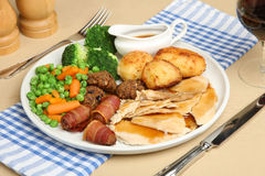 Roast Chicken Dinner. Traditional roast chicken dinner with all the trimmings Stock Photos