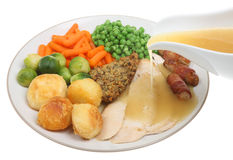 Roast Chicken Dinner with Gravy. Being poured over the meat Royalty Free Stock Photo