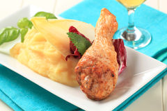 Roast chicken drumstick with mashed potato Royalty Free Stock Photo