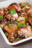 Roast chicken drumsticks with olives Royalty Free Stock Photography