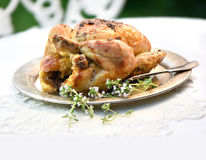 Roast chicken with fresh thyme herbs and flowers Stock Photos