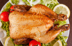 Roast chicken with fresh vegetables stock image