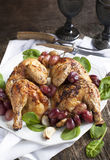 Roast chicken with grapes Stock Photo