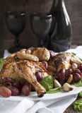 Roast chicken with grapes Royalty Free Stock Image