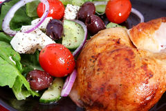 Roast Chicken and Greek Salad Royalty Free Stock Image