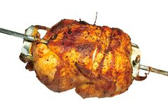 Roast chicken on grill skewer. Isolated on white background Stock Photo
