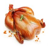 Roast chicken isolated. Roast chicken with rosemary spice  isolated on white background Stock Photography