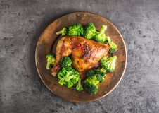 Roast chicken Leg. Chicken roasted leg with broccoli on concrete Stock Image