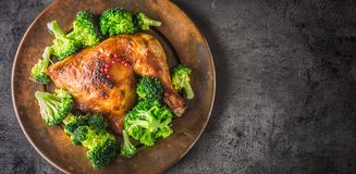 Roast chicken Leg. Chicken roasted leg with broccoli on concrete Royalty Free Stock Image
