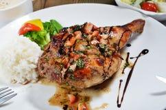 Roast chicken leg Stock Images