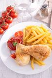 Roast chicken leg and fries Royalty Free Stock Photography