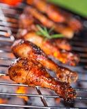 Roast chicken leg on grill Stock Photography