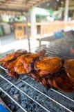 Roast chicken leg on grill Stock Photo