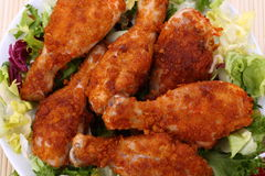 Roast chicken legs. With vegetables royalty free stock images