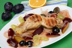 Roast chicken legs. In fruit sauce Royalty Free Stock Image