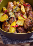 Roast chicken legs with potatoes Stock Photos
