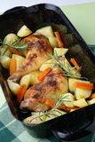 Roast chicken legs with potatoes and vegetable Stock Photo