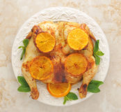 Roast chicken with lemon and honey - whole chicken on a platter Royalty Free Stock Image