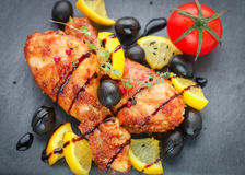 Roast chicken with lemon, olives, tomato and thyme Stock Image