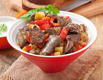 Roast chicken liver with vegetables Stock Photos