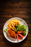 Roast chicken meat, french fries and vegetables Stock Photo