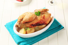 Roast chicken and new potatoes Stock Photography